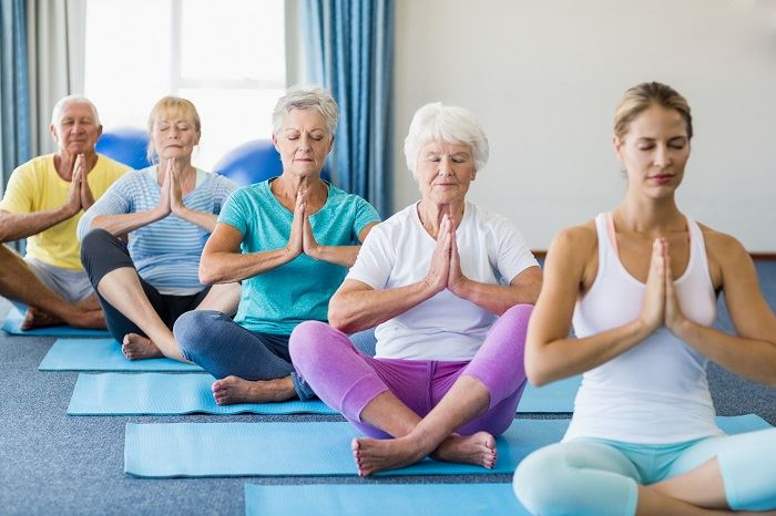 yoga, adults sitting on ground in yoga pose