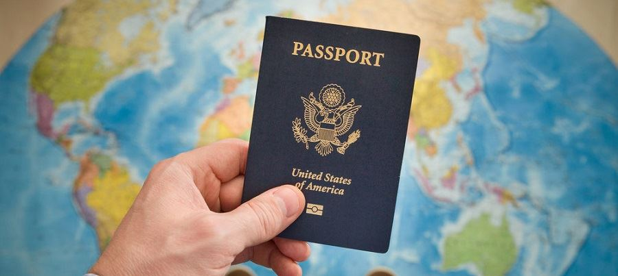 U.S Passport book with a map background.
